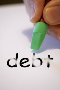 "Image of the word ""debt"" being erased, to illustrate the complex relationship between bankruptcy and divorce and how an NJ divorce attorney can help"